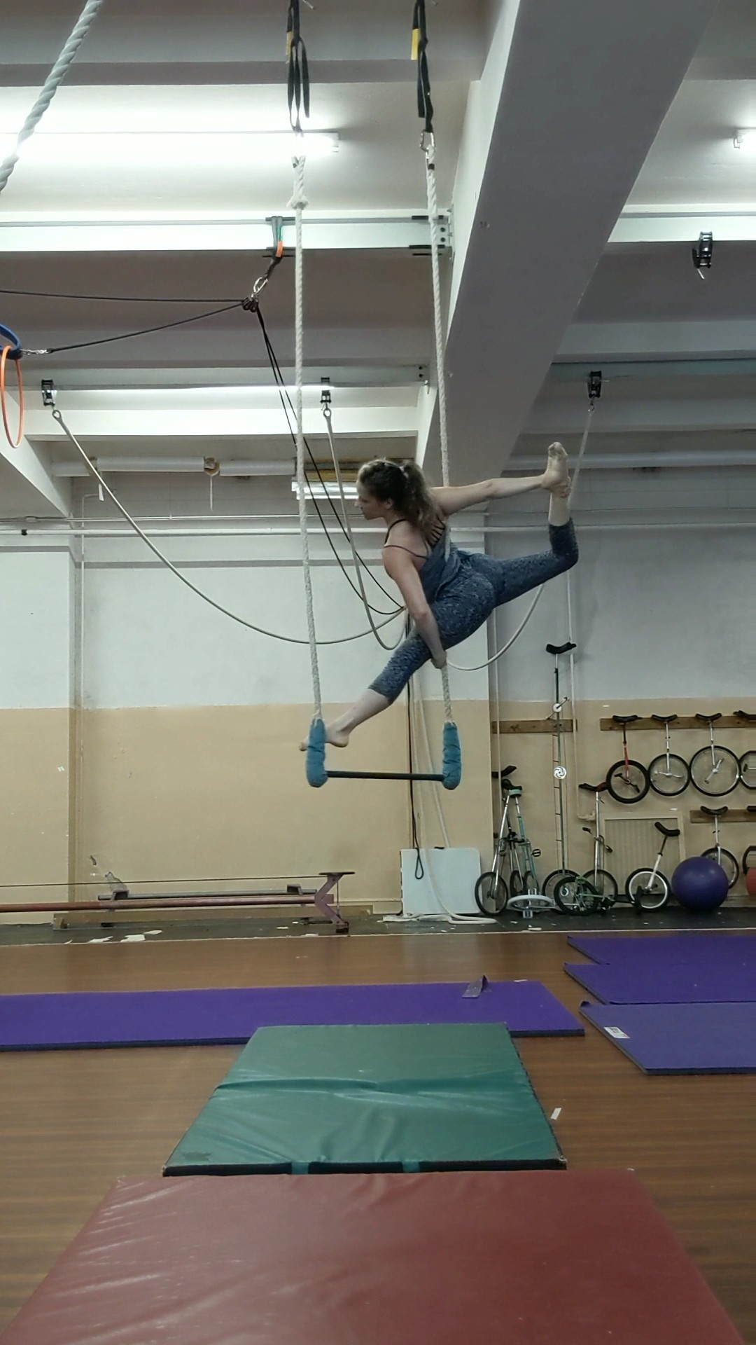 Megan making a ballerina shape on trapeze