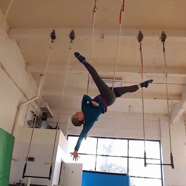 Megan upside down on trapeze