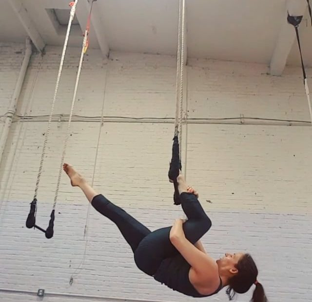Megan in a single heel hang on trapeze